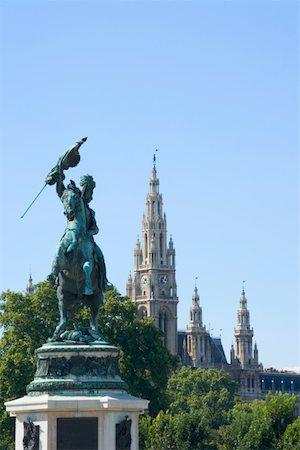 Austria, Vienna, Statue of archduke Karl, town hall in background Stock Photo - Premium Royalty-Free, Code: 613-01289038