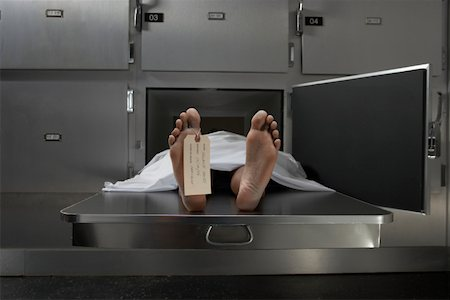 dead female body - Cadaver on autopsy table, label tied to toe Stock Photo - Premium Royalty-Free, Code: 613-01292633