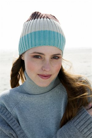 Young woman on beach, portrait, close-up Stock Photo - Premium Royalty-Free, Code: 613-01370169
