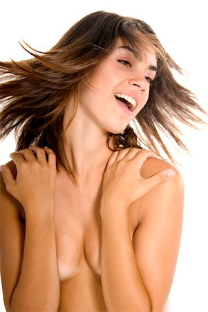Young woman covering breasts with arms and shaking head Stock Photo - Premium Royalty-Free, Code: 613-01371383