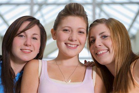Three teenage girls (15-17) smiling, portrait, close-up Stock Photo - Premium Royalty-Free, Code: 613-01388623