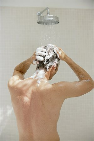 Man washing hair in shower, rear view Stock Photo - Premium Royalty-Free, Code: 613-01383108