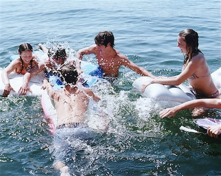 Group of teens (16-18) playing in lake, elevated view Stock Photo - Premium Royalty-Free, Code: 613-01471869