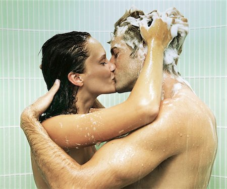 Couple kissing in shower, woman shampooing man's hair Stock Photo - Premium Royalty-Free, Code: 613-01472738
