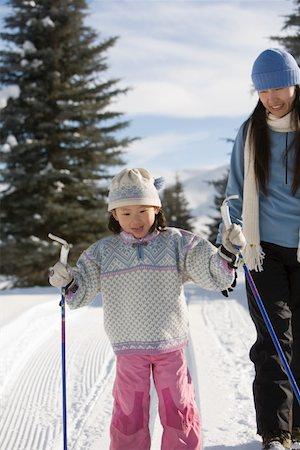 Mother teaching daughter (4-6) how to cross-country ski, smiling Stock Photo - Premium Royalty-Free, Code: 613-01534970