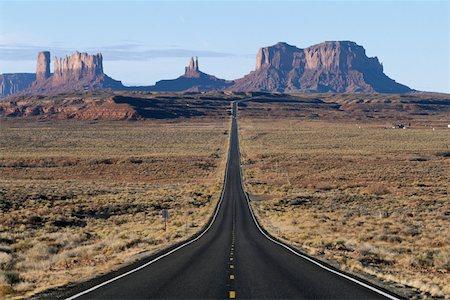 road landscape - USA, Arizona, Monument Valley Tribal Park, highway leading to mesas Stock Photo - Premium Royalty-Free, Code: 613-01531857