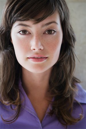 Young woman, close-up, portrait Stock Photo - Premium Royalty-Free, Code: 613-01543523