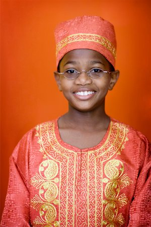 preteen  smile  one  alone - Portrait of boy (12-13) in traditional African costume Stock Photo - Premium Royalty-Free, Code: 613-01778773