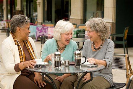 Three senior women sitting at cafe table, laughing Stock Photo - Premium Royalty-Free, Code: 613-01881521