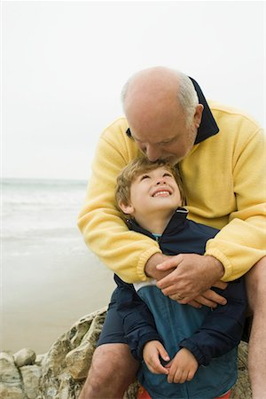 southern california - Senior man with grandson (8-9) sitting on beach Stock Photo - Premium Royalty-Free, Code: 613-02044689