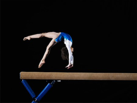 preteen girls gymnastics - Gymnast (9-10) flipping on balance beam, side view Stock Photo - Premium Royalty-Free, Code: 613-02045342