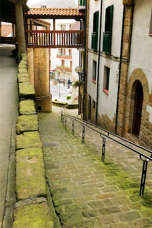 High angle view of an empty alleyway leading to the street, Spain Stock Photo - Premium Royalty-Free, Code: 625-00804501