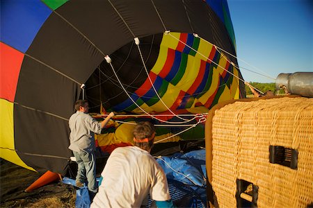 Rear view of two mid adult men near hot air balloon Stock Photo - Premium Royalty-Free, Code: 625-00805513