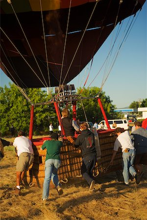 Rear view of people pulling hot air balloon Stock Photo - Premium Royalty-Free, Code: 625-00806221