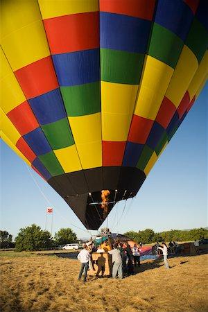 Hot air balloon preparing to take off Stock Photo - Premium Royalty-Free, Code: 625-00806363