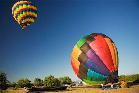 Hot air balloon preparing to take off Stock Photo - Premium Royalty-Free, Code: 625-00801301