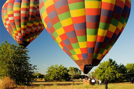 Hot air balloon preparing to take off Stock Photo - Premium Royalty-Free, Code: 625-00801395
