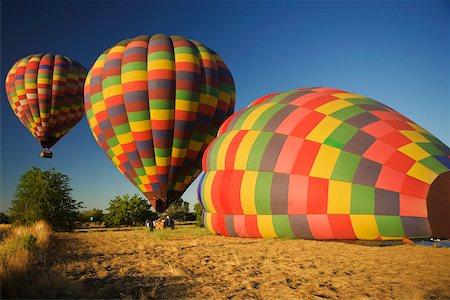 Hot air balloons preparing to take off Stock Photo - Premium Royalty-Free, Code: 625-00801638