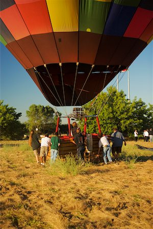 Rear view of people pulling hot air balloon Stock Photo - Premium Royalty-Free, Code: 625-00801658
