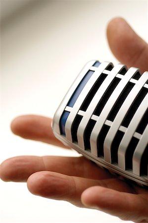 Human hand holding microphone Stock Photo - Premium Royalty-Free, Code: 625-00801904
