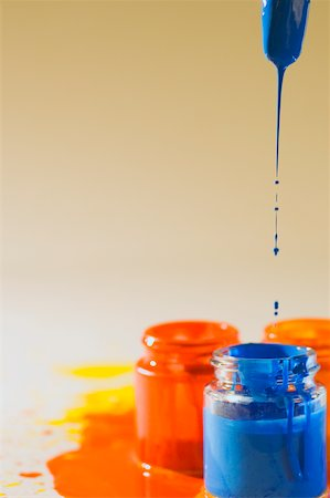 dripping colour art - Paint dripping from a paintbrush into a bottle of paint Stock Photo - Premium Royalty-Free, Code: 625-00836604