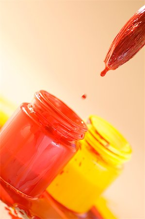 dripping colour art - Close-up of a paintbrush over a bottle of red paint Stock Photo - Premium Royalty-Free, Code: 625-00836609