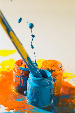 dripping colour art - Close-up of a paintbrush dipped into a bottle of paint Stock Photo - Premium Royalty-Free, Code: 625-00836601