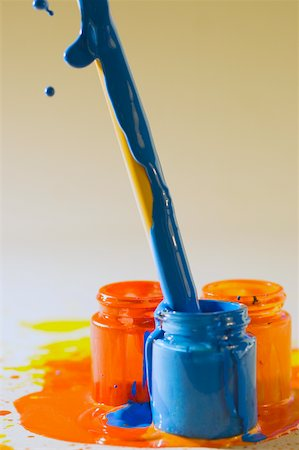 dripping colour art - Close-up of a paintbrush dipped into a bottle of paint Stock Photo - Premium Royalty-Free, Code: 625-00836603