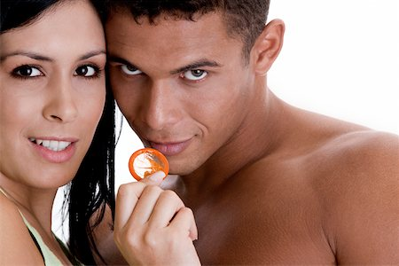 Portrait of a young couple holding a condom Stock Photo - Premium Royalty-Free, Code: 625-00837635