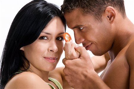 Close-up of a young couple holding a condom Stock Photo - Premium Royalty-Free, Code: 625-00837637