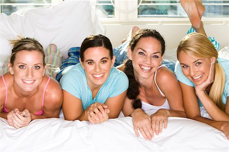 Portrait of four young women smiling Stock Photo - Premium Royalty-Free, Code: 625-00839046