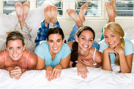 Portrait of four young women smiling Stock Photo - Premium Royalty-Free, Code: 625-00839047
