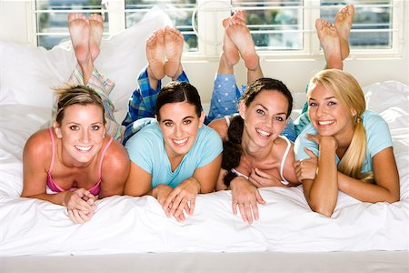 Portrait of four young women smiling Stock Photo - Premium Royalty-Free, Code: 625-00839048