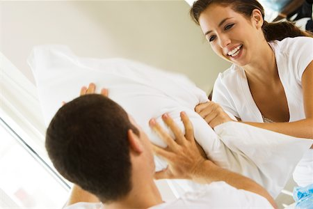 student fighting - Close-up of a young couple having a pillow fight Stock Photo - Premium Royalty-Free, Code: 625-00839077
