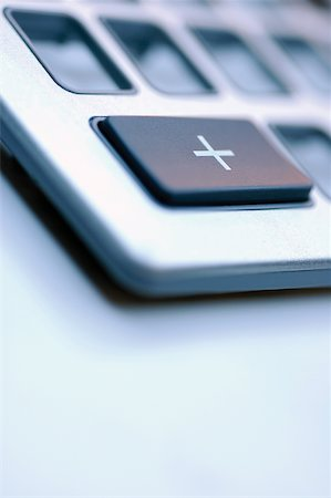 Close-up of an addition button on a calculator Stock Photo - Premium Royalty-Free, Code: 625-00840028