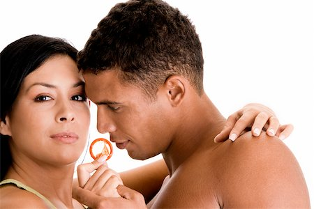 Close-up of a young couple holding a condom Stock Photo - Premium Royalty-Free, Code: 625-00841273