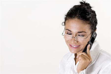 Close-up of a young woman talking on a mobile phone Stock Photo - Premium Royalty-Free, Code: 625-00841397
