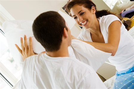 student fighting - Close-up of a young couple having a pillow fight Stock Photo - Premium Royalty-Free, Code: 625-00842331
