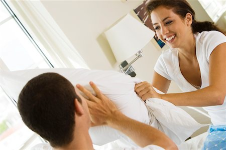 student fighting - Close-up of a young couple having a pillow fight Stock Photo - Premium Royalty-Free, Code: 625-00842332