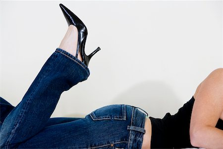 Close-up of a woman wearing stilettos Stock Photo - Premium Royalty-Free, Code: 625-00850617