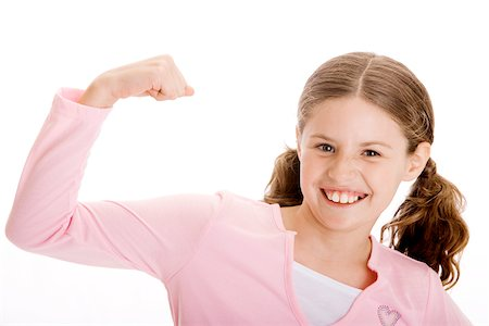Portrait of a girl flexing her biceps Stock Photo - Premium Royalty-Free, Code: 625-00850952
