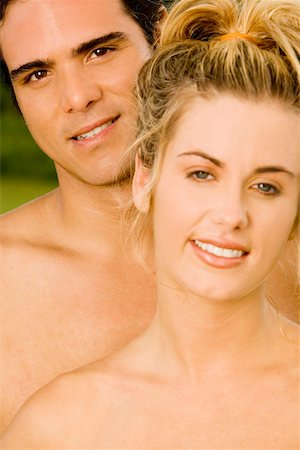 Portrait of a young couple smiling Stock Photo - Premium Royalty-Free, Code: 625-00851472