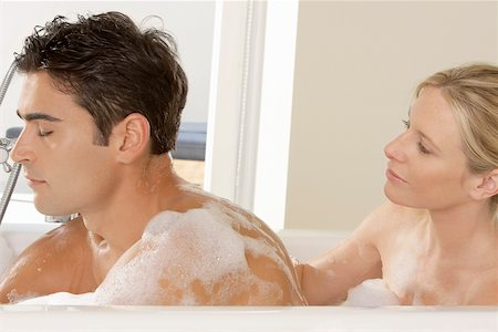 Close-up of a young couple in a bathtub Stock Photo - Premium Royalty-Free, Code: 625-00902459