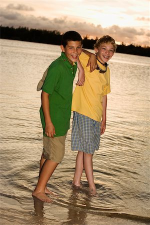 Portrait of two boys standing on the beach Stock Photo - Premium Royalty-Free, Code: 625-01039545
