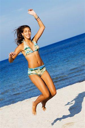 Teenage girl jumping on the beach Stock Photo - Premium Royalty-Free, Code: 625-01097979