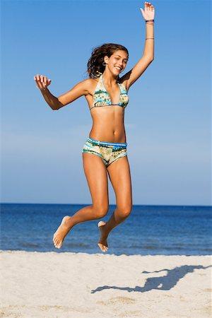 Teenage girl jumping on the beach Stock Photo - Premium Royalty-Free, Code: 625-01097994