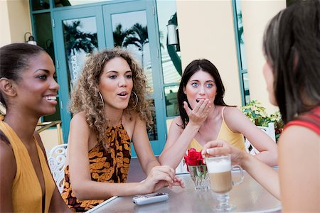Four teenage girls sitting together and gossiping Stock Photo - Premium Royalty-Free, Code: 625-01093786