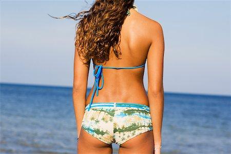 Rear view of a girl wearing a bikini Stock Photo - Premium Royalty-Free, Code: 625-01093821