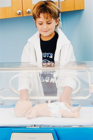 Close-up of a boy standing near an incubator Stock Photo - Premium Royalty-Free, Code: 625-01249665