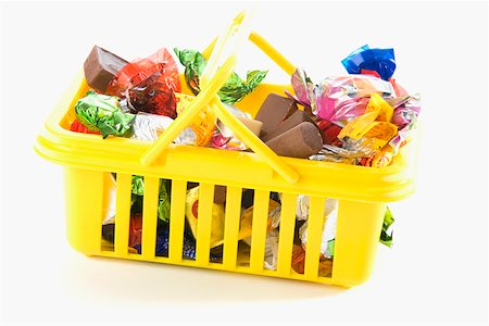 Close-up of chocolates and gifts in a basket Stock Photo - Premium Royalty-Free, Code: 625-01250196
